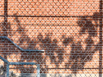 Fence and red brick wall Royalty Free Stock Images