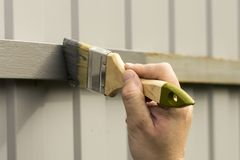 Fence repair in paint and paint royalty free stock photo