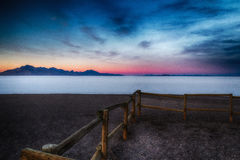 Fence By the Salt Flats HDR Glow. Bonneville Salt Flats at sunset in the western desert of Utah with a wooden fence on the beach Stock Image