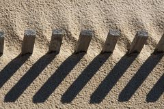 Fence on the sand Stock Photos