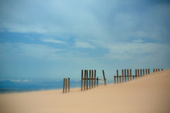 Fence in Sand Royalty Free Stock Photography
