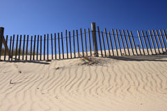 Fence on Sand Dune Stock Image
