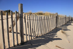 Fence on Sand Dune. Rail Fence partially Buried on Sand Dune Stock Images