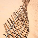 Fence in the sand Stock Photo