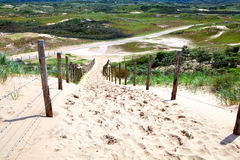 Fence by sand path to dunes Royalty Free Stock Photography