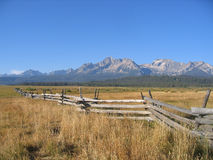 Fence and Sawtooth Mountains. Wood Fence with the Sawtooth Mountains in the Background near Stanely, Idaho Royalty Free Stock Photo