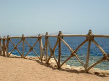 Fence sea beach. Fence on the sea beach Royalty Free Stock Images