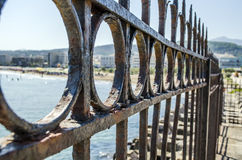 Fence. With sea and town background Royalty Free Stock Images