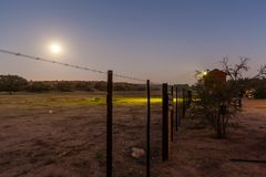 The fence that separates the wild animals from the campers. In Nossob campsite in the Kgalagadi Transfrontier Park, South Africa stock photography