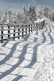 Fence and shadow in the winter. Fence and its shadow at the beginning of a ski slope Royalty Free Stock Photography
