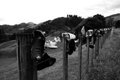 Fence of shoes Royalty Free Stock Photo