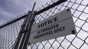 Fence with Sign Authorized Personnel Only   ALABAMA OCTOBER 16, 2013. Fence with Sign Authorized Personnel Only   ALABAMA/USA OCTOBER 16, 2013 stock video footage
