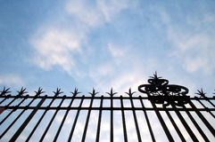 Fence silhouette. The sky seen through a gate at Versailles castle stock image