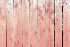 Fence of smooth wooden boards. Reddish vertical slats. Background with texture royalty free stock photo