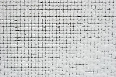 Fence with snow. Metal checked fence with snow stuck in cells Royalty Free Stock Images
