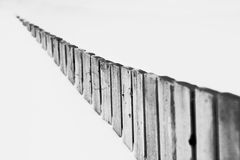 Fence in snow. A half burried fence disapearing into the snowy distance Royalty Free Stock Photography