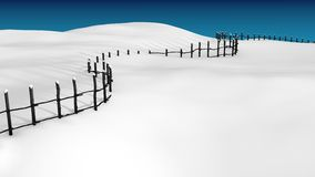 Fence in the snow. Wooden fence in deep snow in clear weather with a plenty of copy space Royalty Free Stock Image
