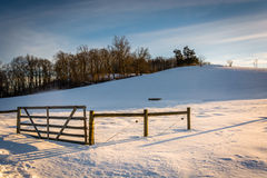 Fence in a snow-covered farm field in rural York County, Pennsyl Royalty Free Stock Photos
