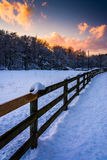 Fence on a snow covered field at sunset, in rural York County, P Stock Photography
