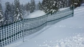 Fence in the snow and fir trees away Stock Photos