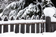 The fence in the snow. Snow fence in the village. Karelia Stock Photos
