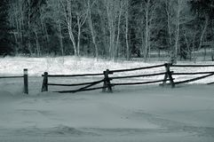 Fence with snow in winter. Winter landscape in black and white showcasing a fence with snow Royalty Free Stock Photos