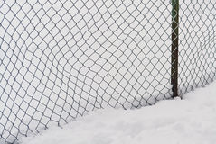 Fence and snow Stock Images