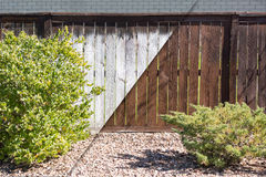 Fence Before and After Solid Paint Stain Application Royalty Free Stock Images