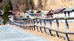 Fence with some typical wooden houses in the background of the v. Illage Sils Maria in Switzerland Engadine valley Royalty Free Stock Photo