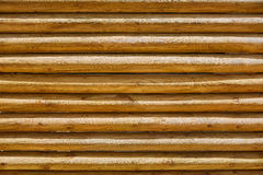 Fence of stacked round trunks wood pattern Stock Photography