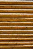 Fence of stacked round trunks wood pattern Stock Images
