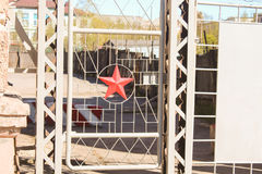 Fence with star. Soviet fence of twigs, Star stock photo