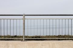 Fence - Steel railing over the sea stock images