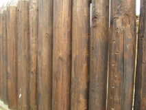 Fence from the stockade. Logs of brown color stock photos