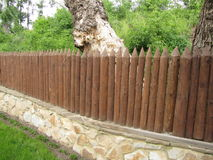 Fence from the stockade. Logs of brown color stock photography