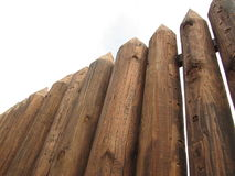 Fence from the stockade. Logs of brown color royalty free stock photography