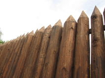 Fence from the stockade. Logs of brown color royalty free stock photos