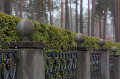 Fence with stone pillars and balls Royalty Free Stock Photo
