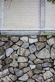 Fence and stone wall texture Royalty Free Stock Photography