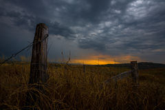 Fence at Stormy Sunset Royalty Free Stock Image