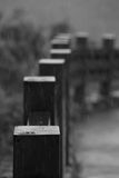 Fence and rainy. A fence is a structure that encloses an area, typically outdoors, and is usually constructed from posts that are connected by boards, wire Royalty Free Stock Image