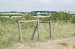 Fence structure by Essex coast. With fields in background royalty free stock images