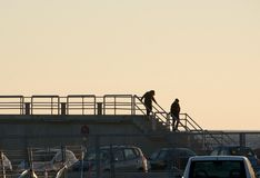 Fence structure silhouette and two people Stock Images