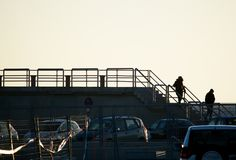 Fence structure silhouette and two people Royalty Free Stock Photos