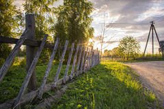 Fence in summer. At sunset Royalty Free Stock Photography