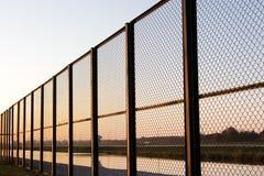 Fence on sundown Royalty Free Stock Images