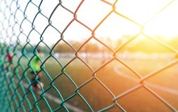 Fence and sunset light in sport club. With player Royalty Free Stock Photos