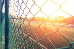 Fence and sunset light in sport club. With player Stock Photography