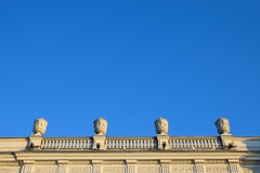 Fence terraces on the roof with a decorative moulded vase. On the Palace embankment in St. Petersburg Stock Photos