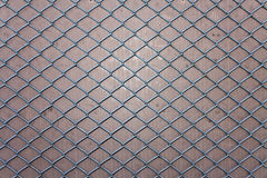 Fence texture. Metallic fence creating a grid and an interesting texture Royalty Free Stock Photos